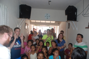 Pastor Mario's church is packed with local children and our team!